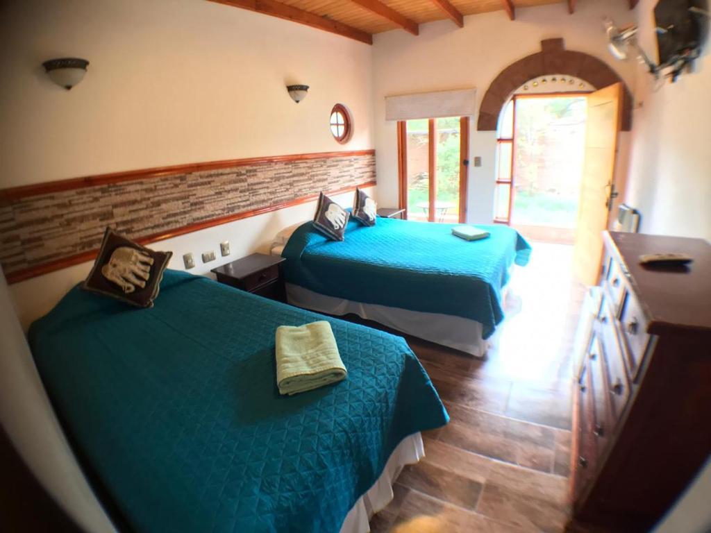 Cama ou camas em um quarto em Hostal Puritama