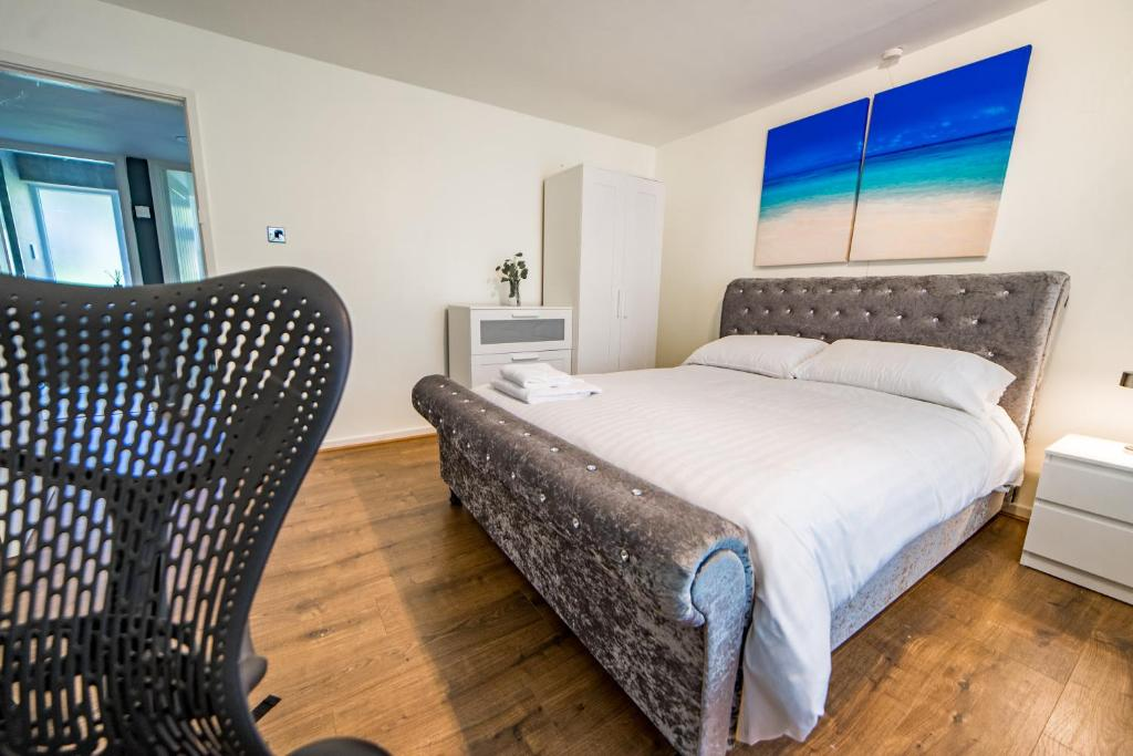 A bed or beds in a room at The Arato