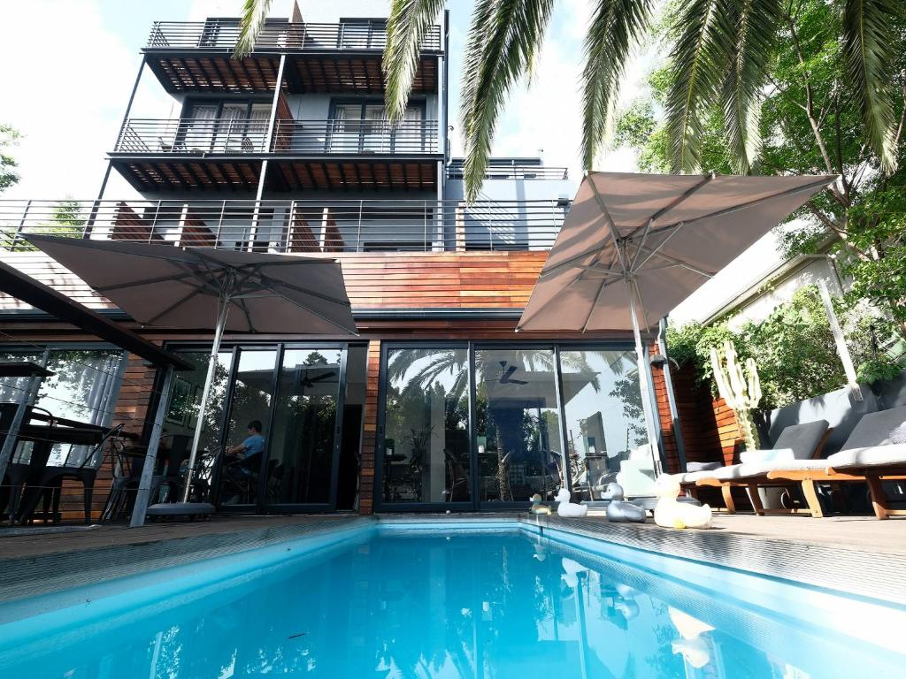 The swimming pool at or near The Tree House Boutique Hotel