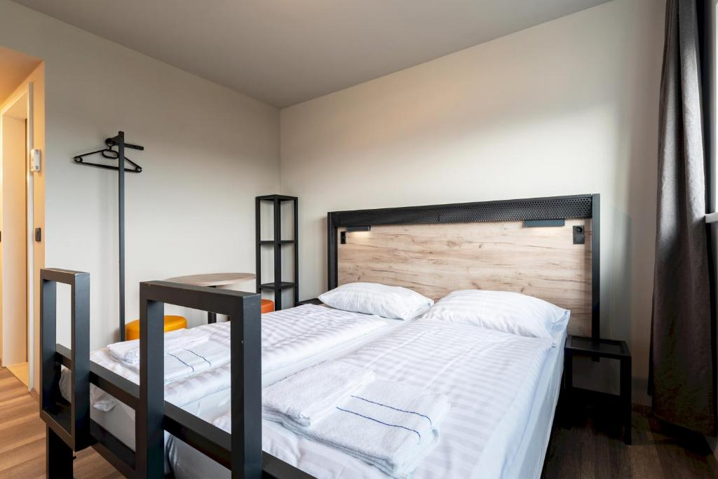 A bed or beds in a room at Wolfgang's managed by a&o
