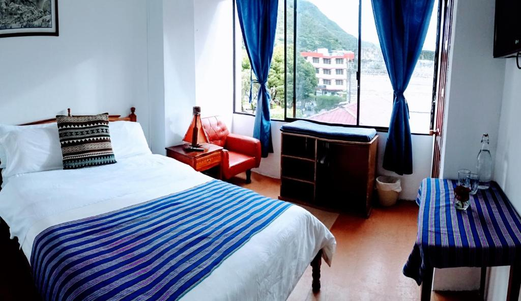 A bed or beds in a room at Erupcion Art Hotel & Hostel