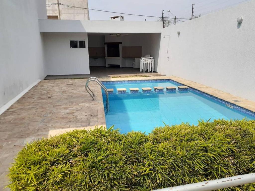 The swimming pool at or near Comoda Casa Condominio 8 pers.3 Dorm.3 Baños