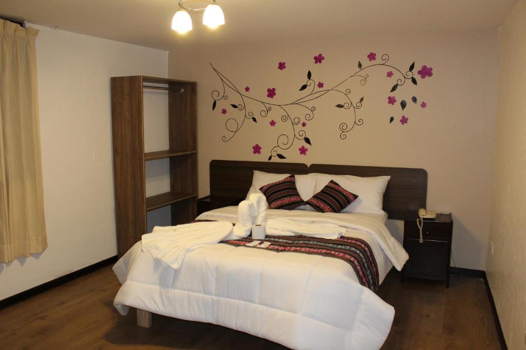 Cama o camas de una habitación en Hotel Illapa Pardo