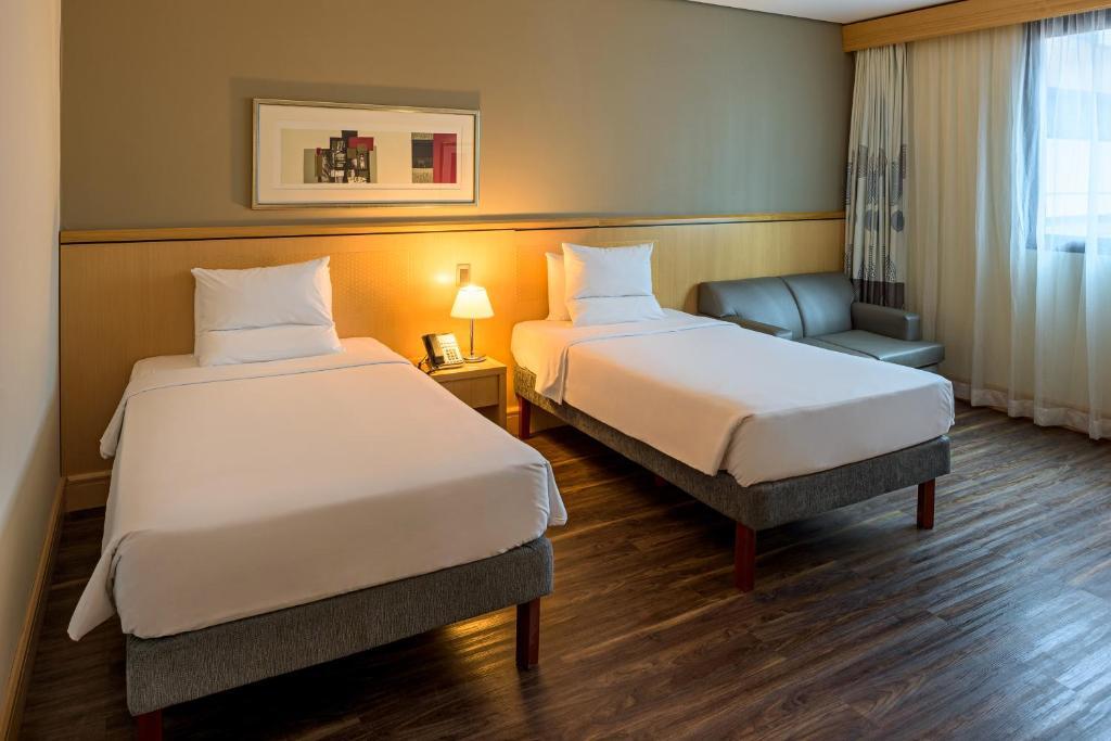Cama o camas de una habitación en Novotel Center Norte