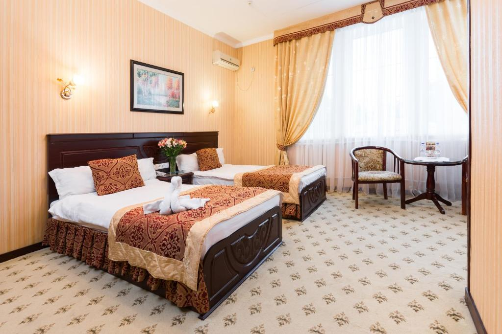 A bed or beds in a room at Asia Hotel Fergana