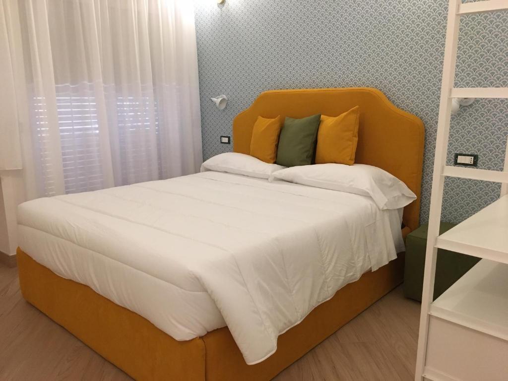 A bed or beds in a room at AFFRESCHI AL VATICANO