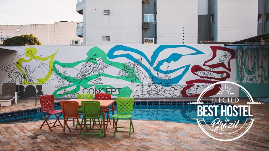 The swimming pool at or near Concept Design Hostel & Suites