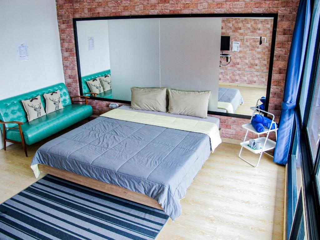 A bed or beds in a room at HOMEY-Donmueang Hostel