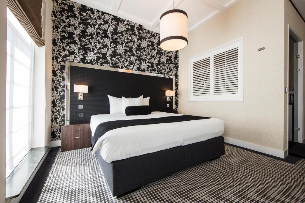 Un ou plusieurs lits dans un hébergement de l'établissement Boutique Hotel Notting Hill