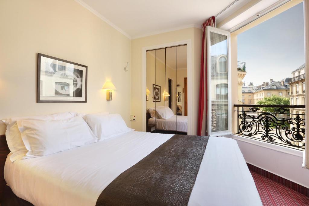 Letto o letti in una camera di Hotel du College de France