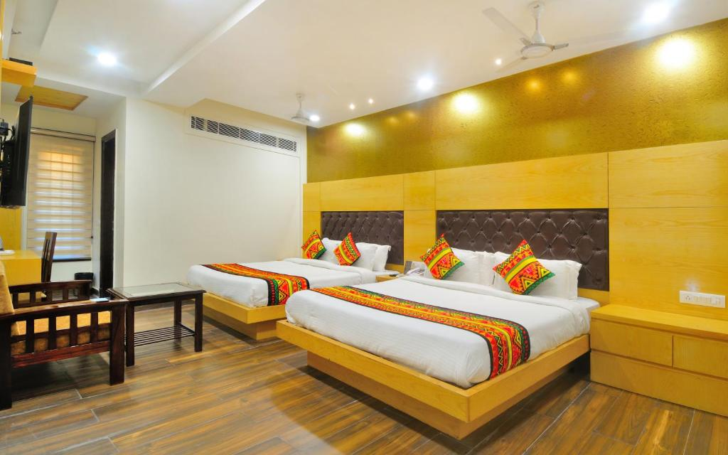 A bed or beds in a room at Hotel Grand Uddhav - Delhi City Center