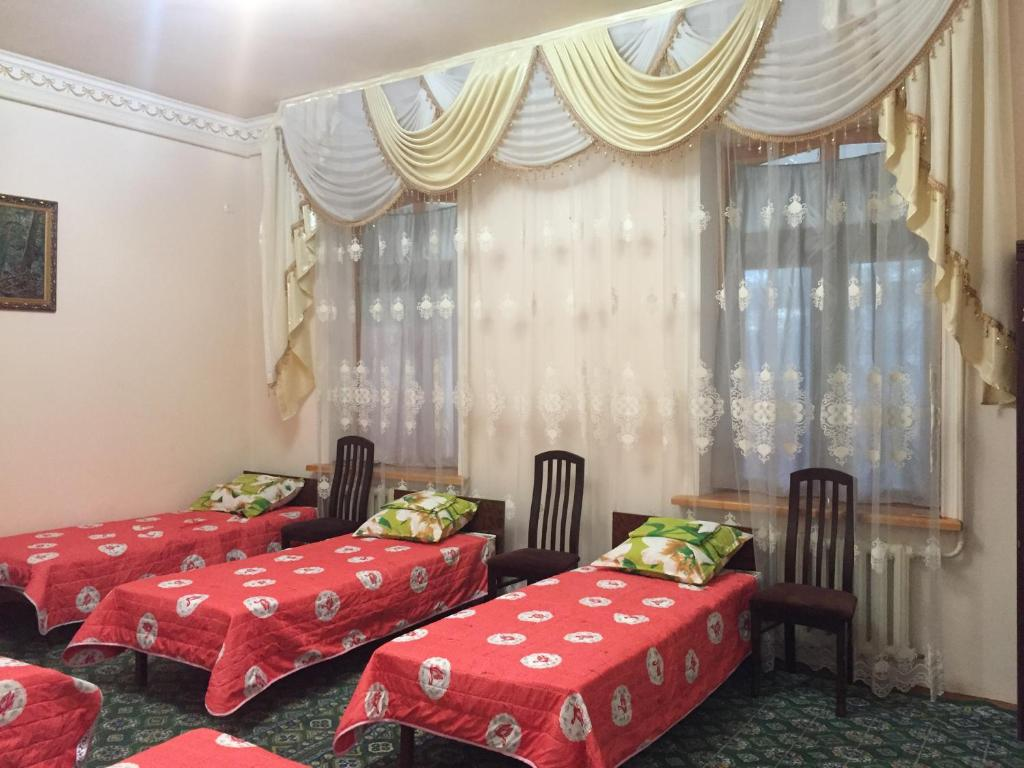 A bed or beds in a room at AHMADJON