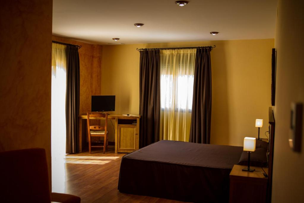 Cama o camas de una habitación en Hotel Rural el Nacimiento