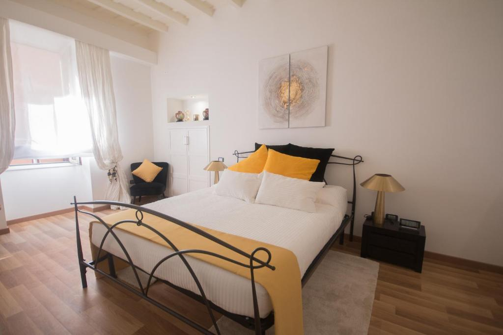 A bed or beds in a room at Barcaccia Luxury Suites