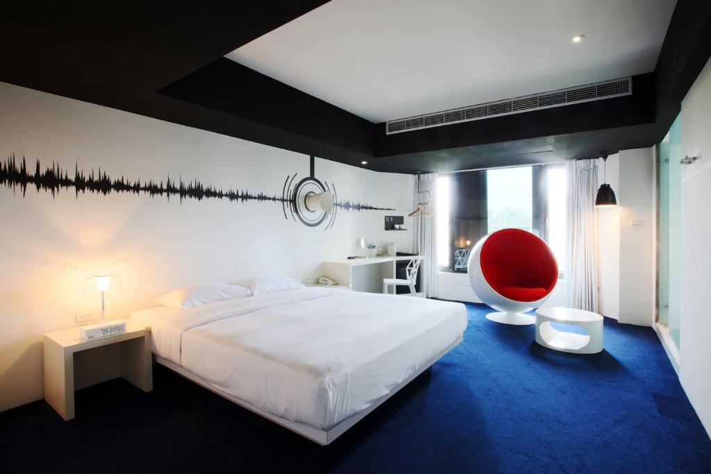 A bed or beds in a room at The Icon Hotel