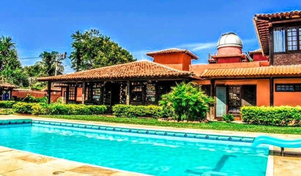 A piscina localizada em Numa Boa Hostel ou nos arredores