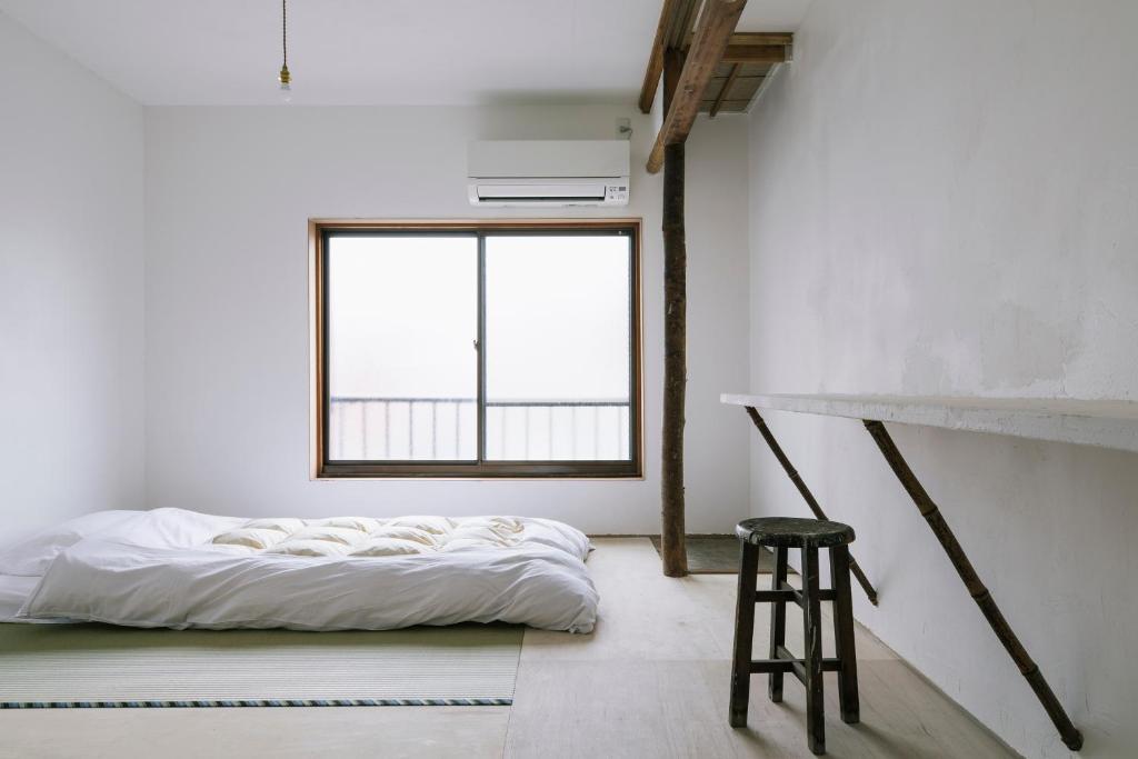 Atelier & Hostel ナギサウラにあるベッド