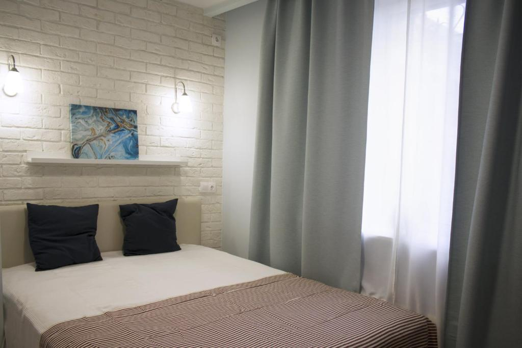 A bed or beds in a room at Apartment 1st Trekhgorka