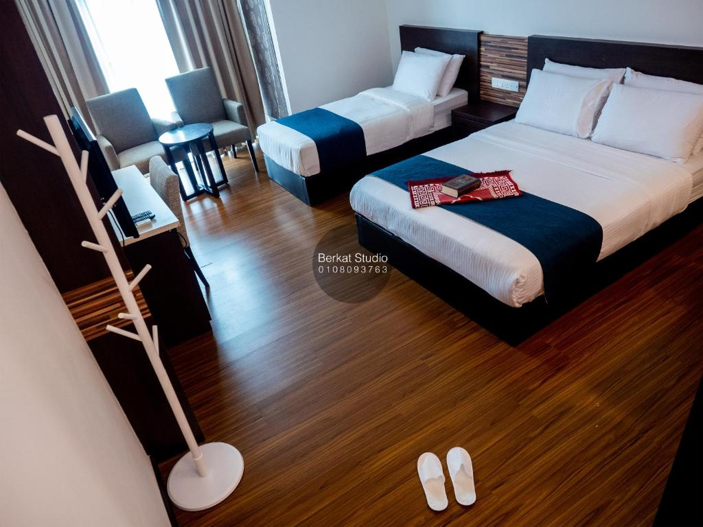 A bed or beds in a room at Berkat Studio (Kota Bharu City Point)