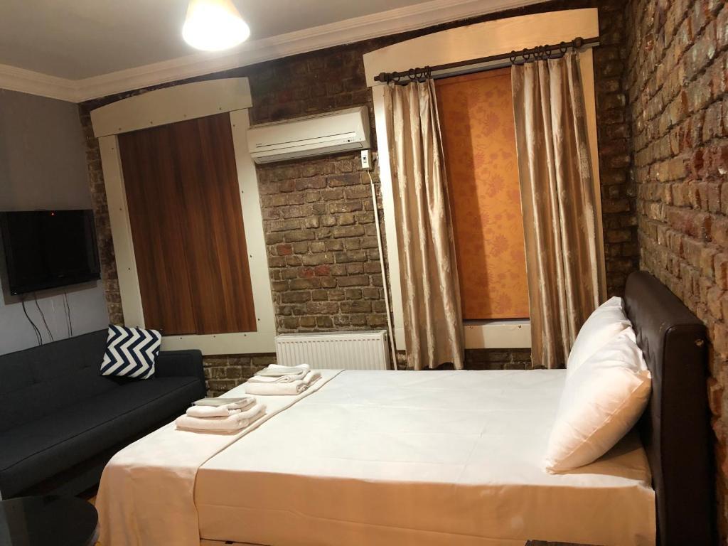 Кровать или кровати в номере Cezayir Butik Otel