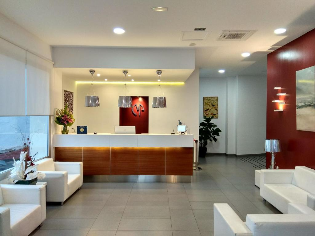 The lobby or reception area at Mena Plaza