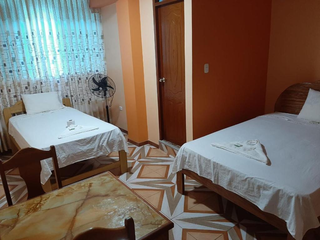 A bed or beds in a room at HOSPEDAJE MORADA DEL EMPERADOR