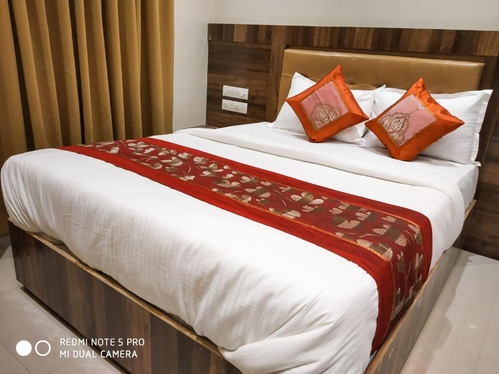 A bed or beds in a room at Rishi International