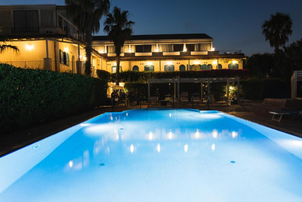 The swimming pool at or near Le Dune Sicily Hotel