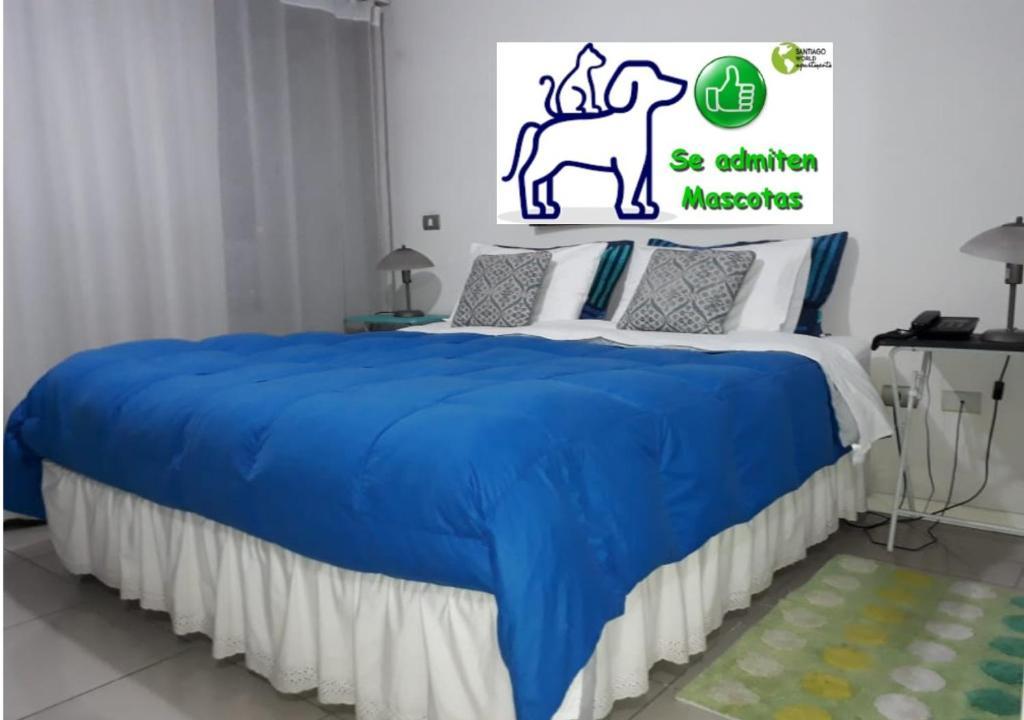 Cama o camas de una habitación en Santiago World Apartments