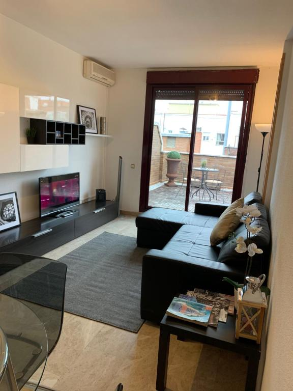 O zonă de relaxare la Stylish City Apartamentos
