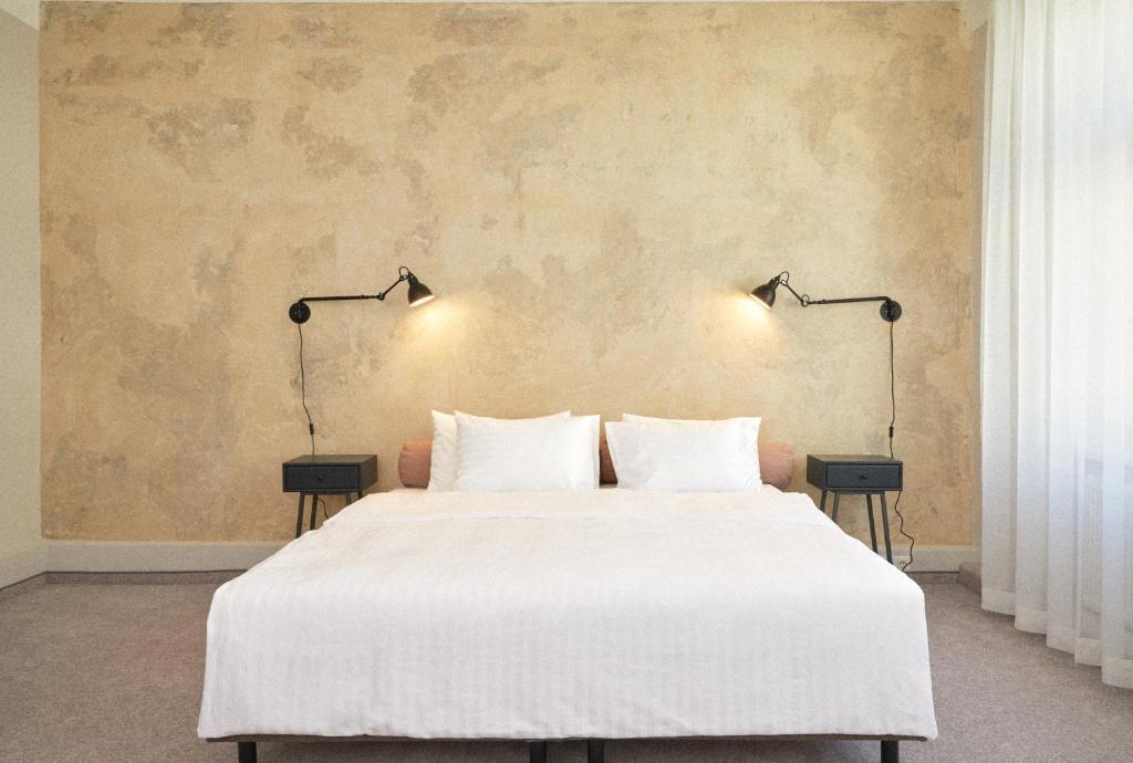 Lova arba lovos apgyvendinimo įstaigoje Hotel Babula am Augarten