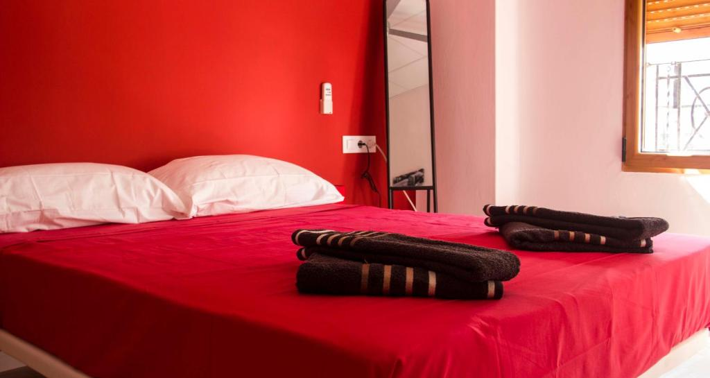 A bed or beds in a room at Colors Rooms
