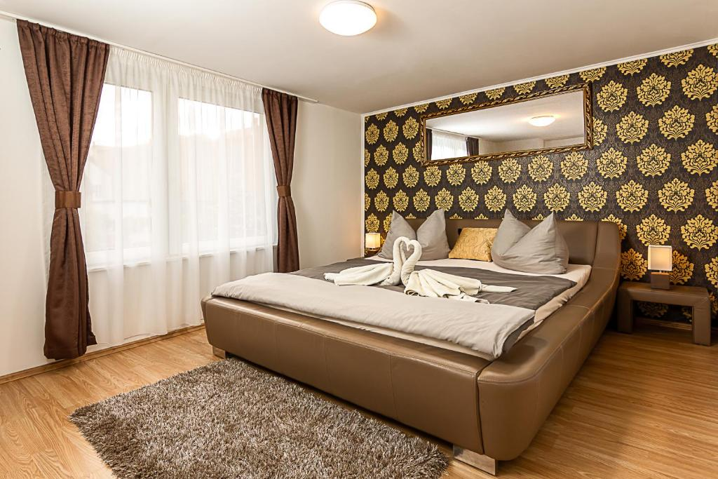 A bed or beds in a room at Kőszeg Panzió