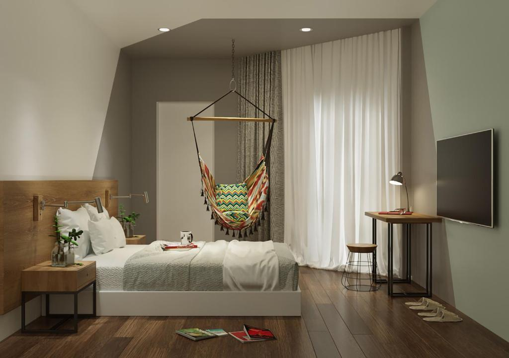 A bed or beds in a room at The MOKA Hotel