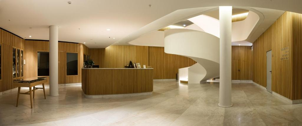 The lobby or reception area at Evora Olive Hotel