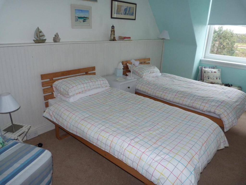 A bed or beds in a room at Briarbank-Dunragit