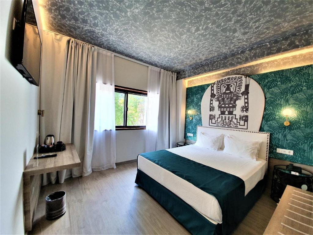 Un ou plusieurs lits dans un hébergement de l'établissement Casual Inca Porto