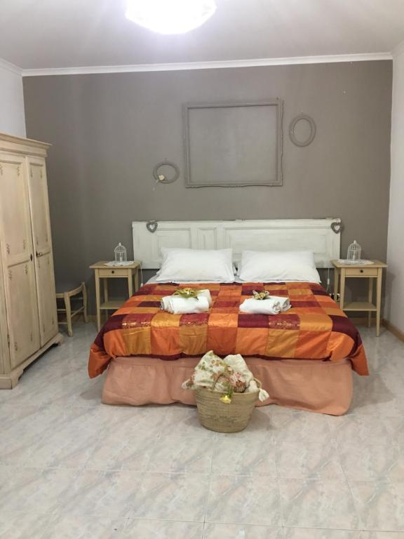 A bed or beds in a room at ST. JOSEPH SUITE