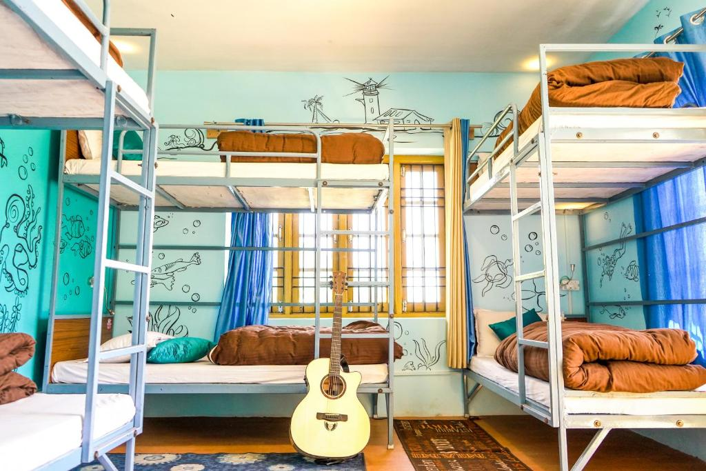A bunk bed or bunk beds in a room at The Bunker - McLeod Ganj