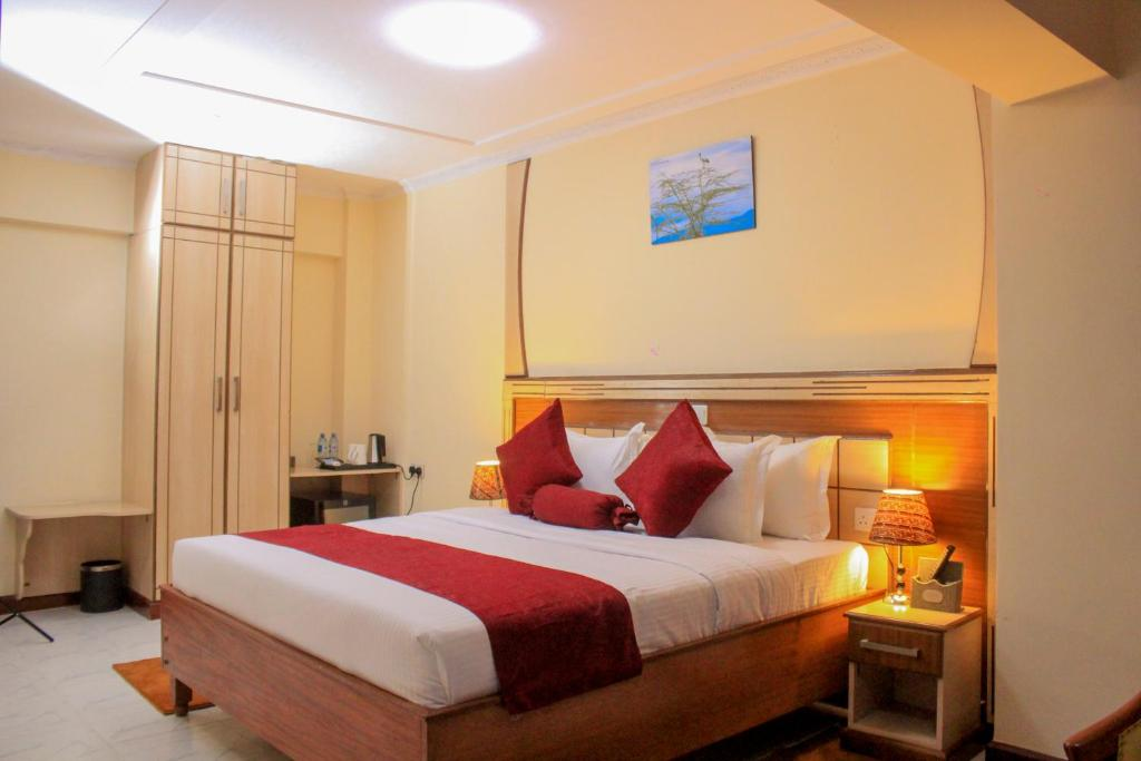 A bed or beds in a room at Empolos Hotel Nakuru