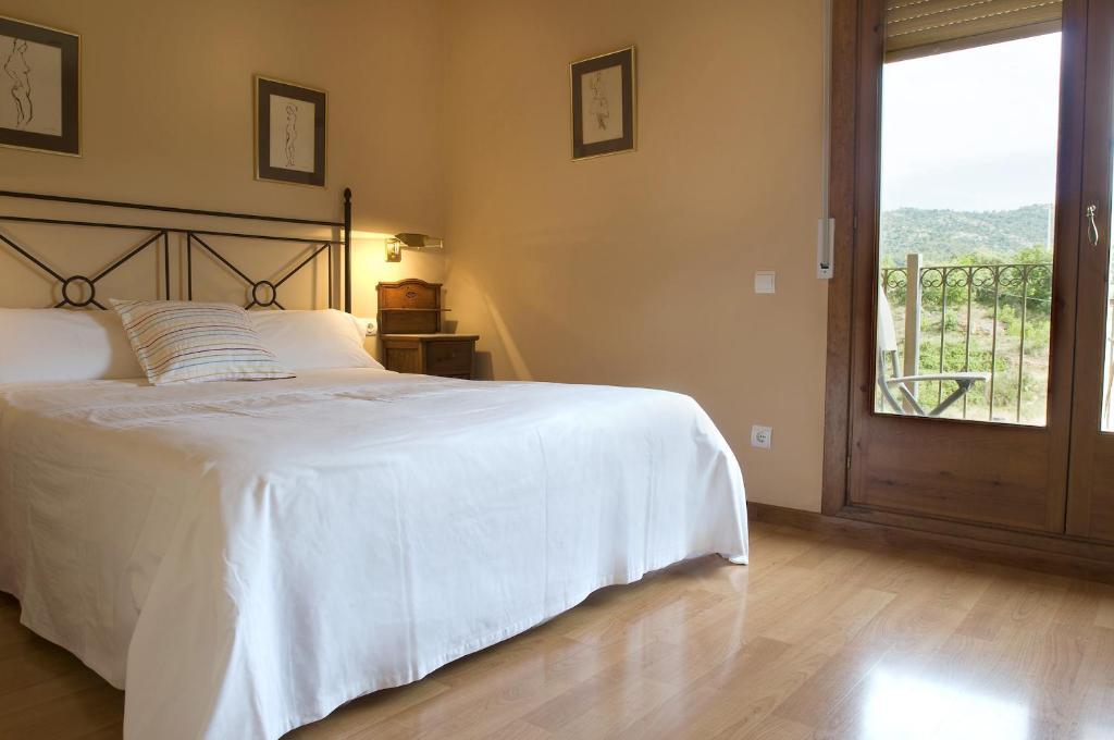 Cama o camas de una habitación en Cal Pastor