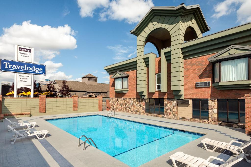 The swimming pool at or near Travelodge by Wyndham Calgary South