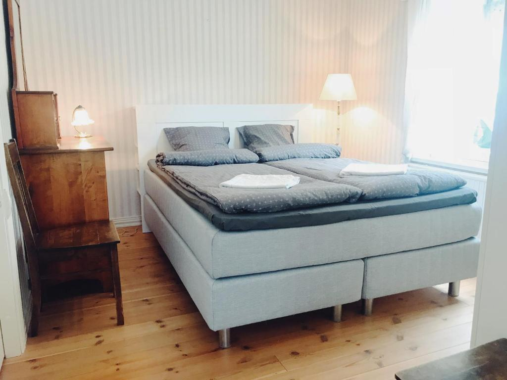 A bed or beds in a room at Small historic wooden house in Porvoo old town