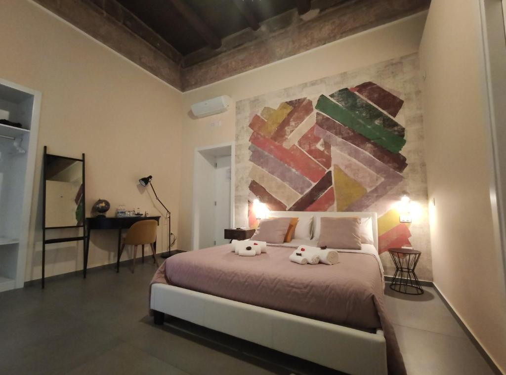 A bed or beds in a room at L'arco e il vico
