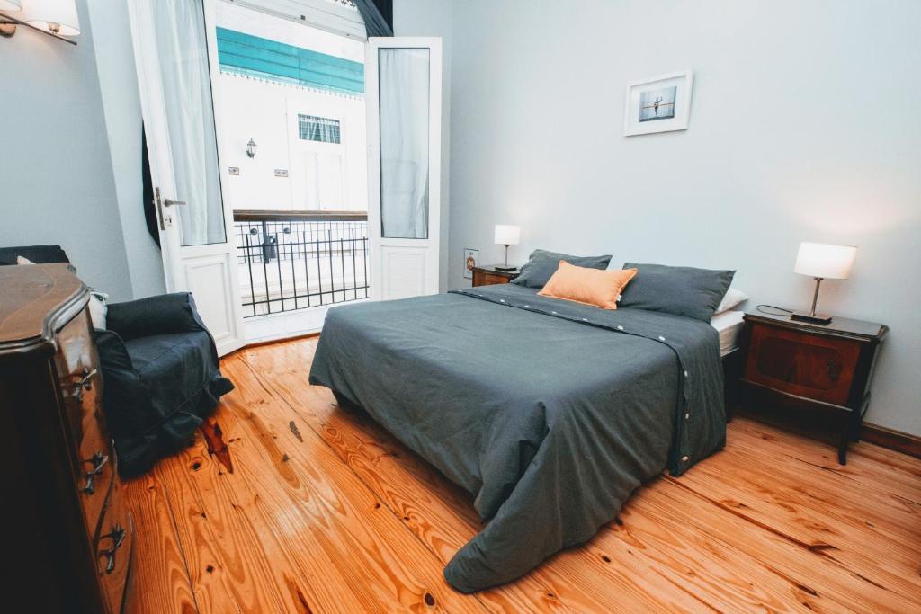 Łóżko lub łóżka w pokoju w obiekcie Milhouse Hostel Hipo