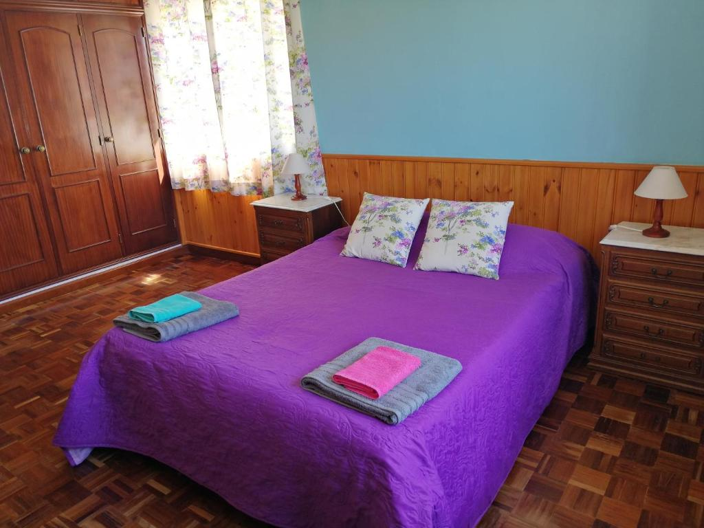 A bed or beds in a room at Casa Sorriso