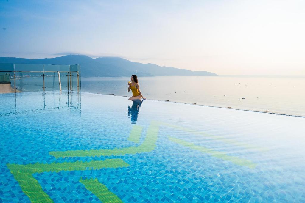 The swimming pool at or close to Maximilan Danang Beach Hotel