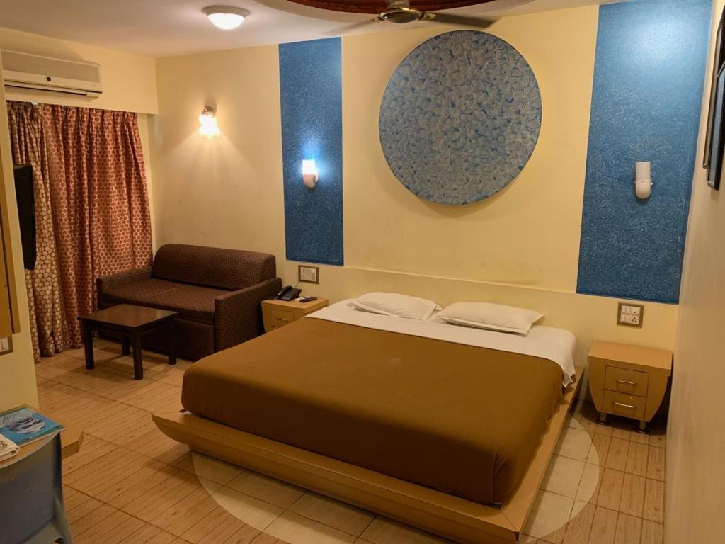 A bed or beds in a room at NEETA INN