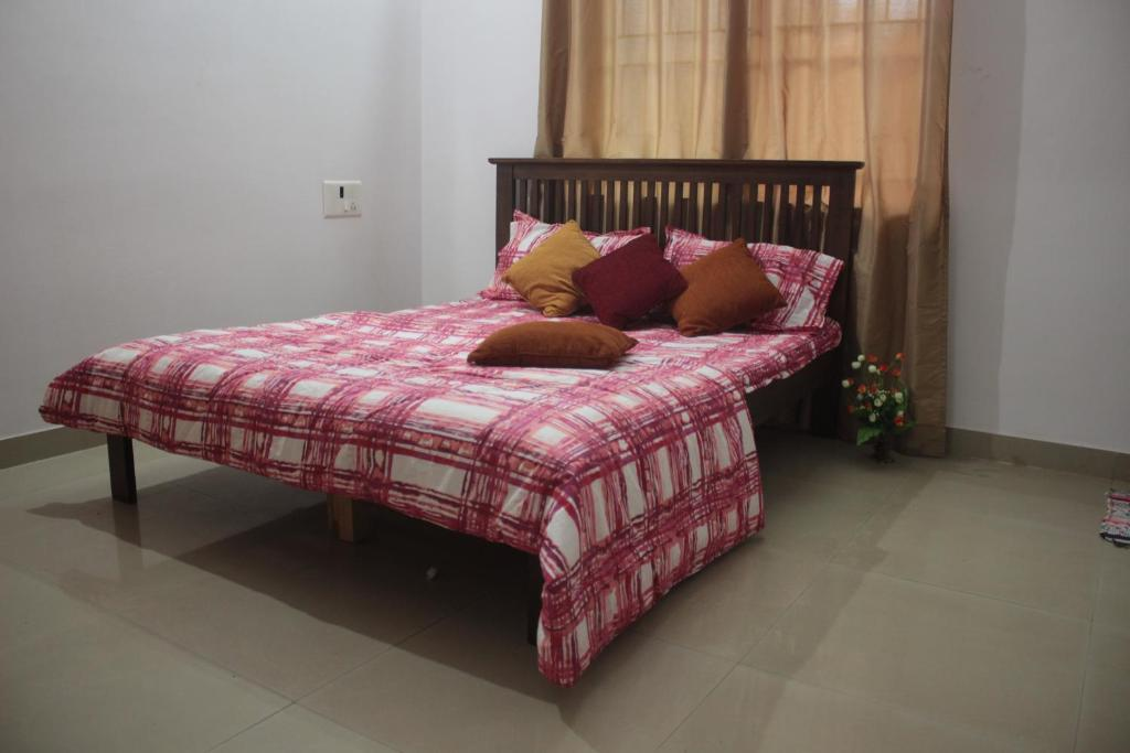 A bed or beds in a room at AnuBNK whitefield