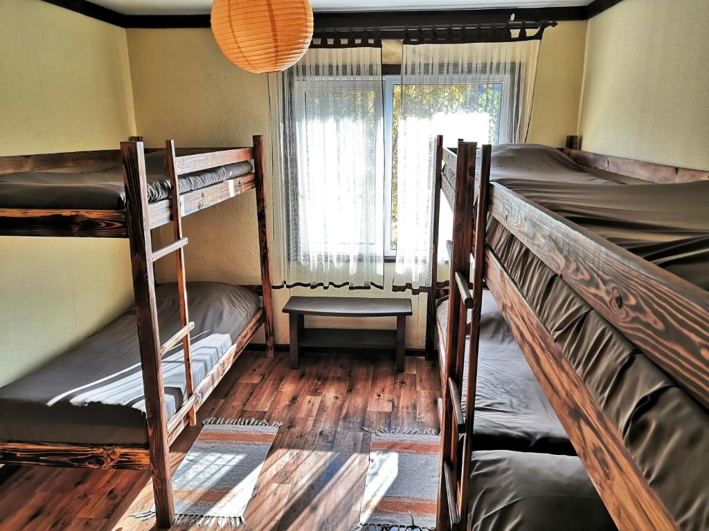A bunk bed or bunk beds in a room at Хостел Улей